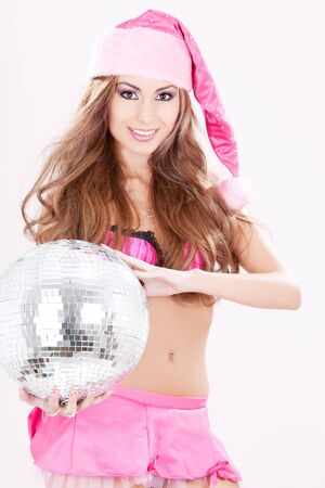 sexy santa helper in pink lingerie with disco ball Stock Photo - 5962386