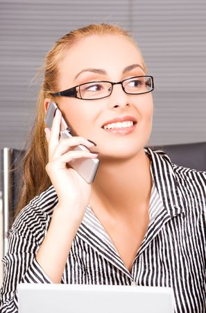 picture of lovely girl with cell phone in office Stock Photo - 5962388