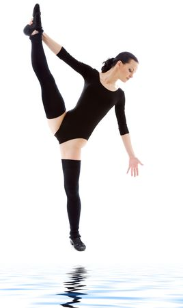 fitness instructor in black leotard over white photo