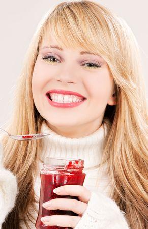 picture of happy teenage girl with raspberry jam photo