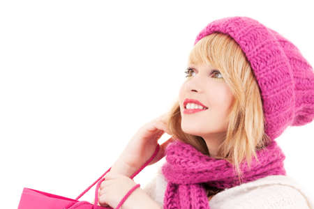 happy teenage girl in hat with pink shopping bags Stock Photo - 5985167
