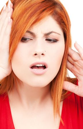 picture of unhappy redhead woman with hands on ears Stock Photo - 5985096