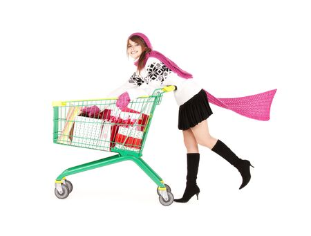 carts: happy teenage girl with shopping cart over white