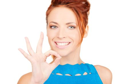 bright picture of lovely redhead showing ok sign Stock Photo - 6000219