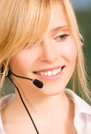 bright picture of friendly female helpline operator Stock Photo - 6000196
