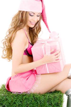 sexy santa helper with gift box over white photo
