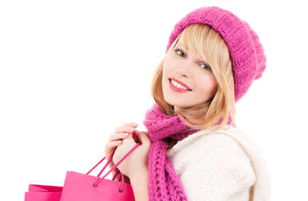 happy teenage girl in hat with pink shopping bags Stock Photo - 6000229