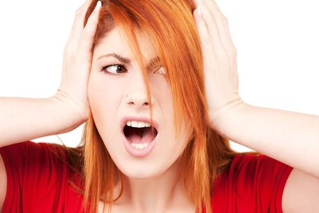 picture of unhappy redhead woman with hands on ears Stock Photo - 6023850