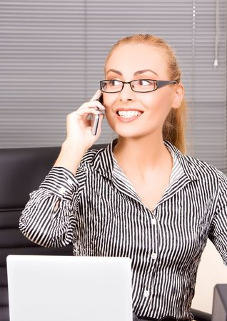 picture of lovely girl with cell phone in office photo