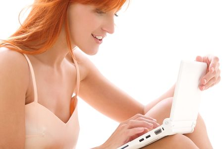 picture of happy redhead woman with laptop computer photo