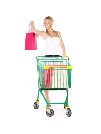 happy woman with shopping bags and cart over white Stock Photo - 6045504