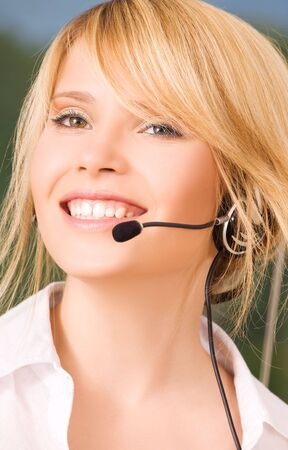 bright picture of friendly female helpline operator Stock Photo - 6045463