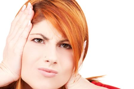 picture of unhappy redhead woman with hands on ears Stock Photo - 6045677