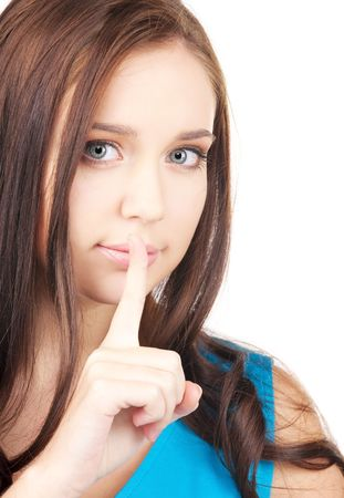 bright picture of young woman with finger on lips Stock Photo - 6071860