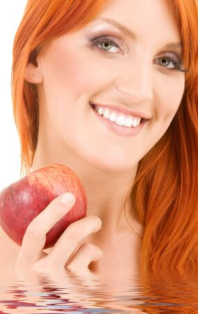 redhead woman with red apple in water Stock Photo - 6071930