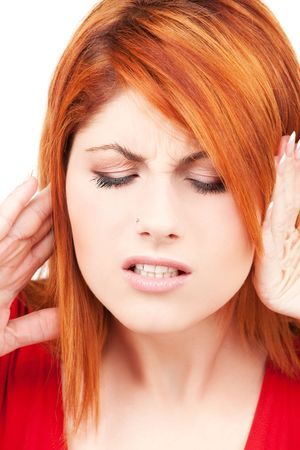 picture of unhappy redhead woman with hands on ears Stock Photo - 6101259