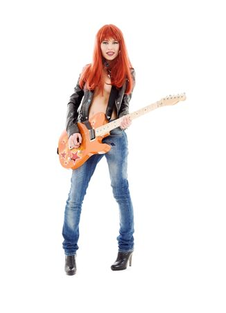 picture of lovely redhead girl with orange guitar Stock Photo - 6100824