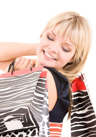 happy woman with shopping bags over white Stock Photo - 6104936