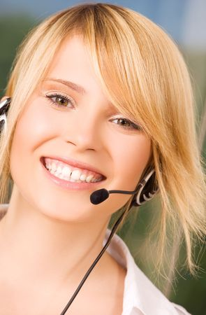 bright picture of friendly female helpline operator Stock Photo - 6104935
