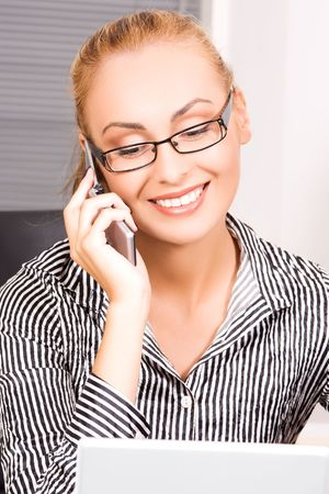 picture of lovely girl with cell phone in office Stock Photo - 6105354