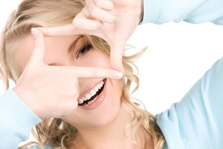 bright picture of lovely blonde creating a frame with fingers Stock Photo - 6101731