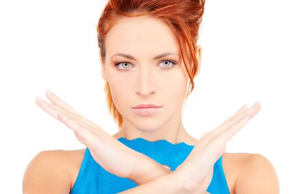 bright picture of young woman making stop gesture Stock Photo - 6105352