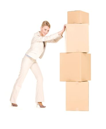 picture of businesswoman with boxes over white Stock Photo - 6105373