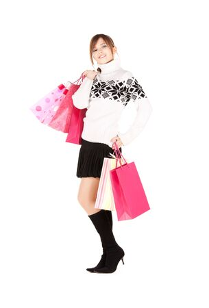 happy teenage girl with shopping bags over white  photo