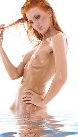 picture of healthy naked redhead in water Stock Photo - 6136237