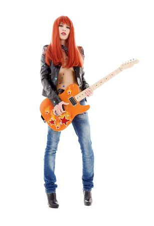 girl playing guitar: picture of lovely redhead girl with orange guitar