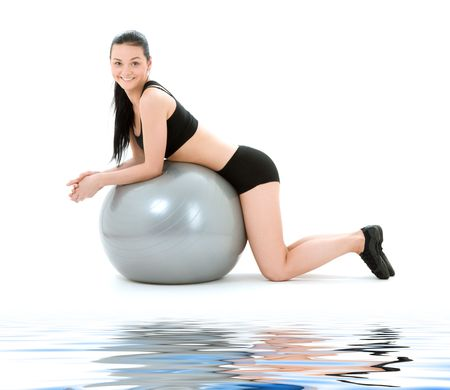 lovely fitness instructor with pilates ball photo