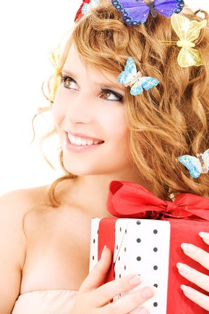 picture of happy girl with gift and butterflies over white photo