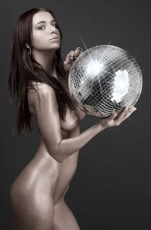 picture of beautiful naked woman with disco ball photo