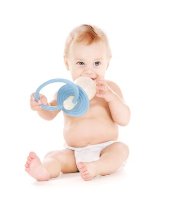 teat: picture of baby boy with big pacifier over white
