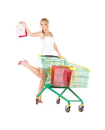 happy woman with shopping cart over white Stock Photo - 6140727