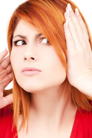 picture of unhappy redhead woman with hands on ears Stock Photo - 6140736