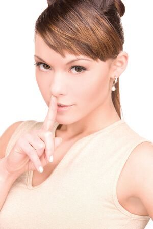 bright picture of young woman with finger on lips Stock Photo - 6166898