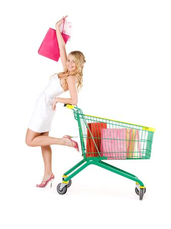 happy woman with shopping bags and cart over white Stock Photo - 6155756