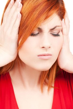 picture of unhappy redhead woman with hands on ears Stock Photo - 6155802