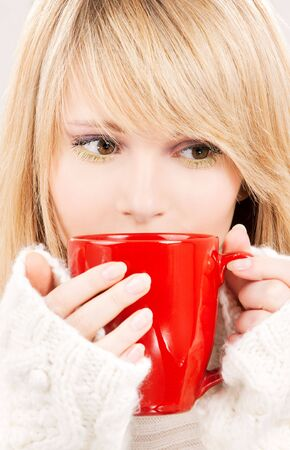 picture of teenage girl with red mug photo