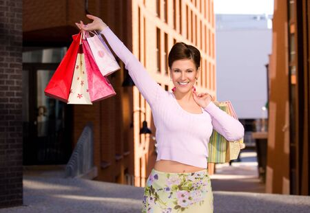 outdoor picture of happy woman with shopping bags Stock Photo - 6357921