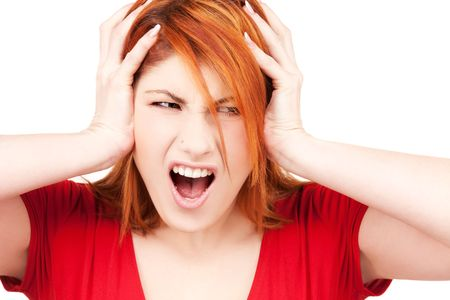 picture of unhappy redhead woman with hands on ears photo