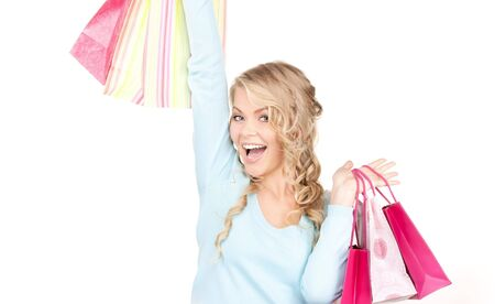 happy woman with shopping bags over white Stock Photo - 6358034