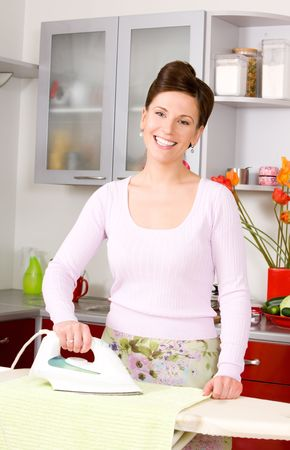 picture of ironing woman in the kitchen photo