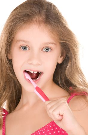 picture of happy girl with toothbrush over white photo