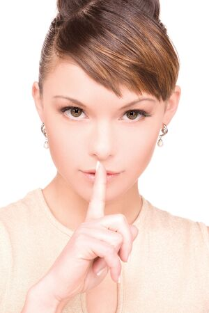 bright picture of young woman with finger on lips Stock Photo - 6375905