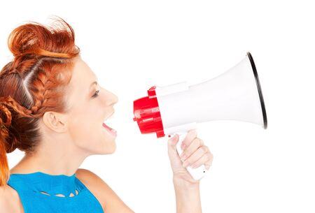 picture of redhead woman with megaphone over white Stock Photo - 6375899
