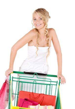 happy woman with shopping bags and cart over white Stock Photo - 6375982