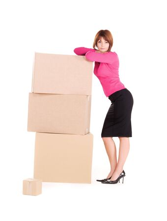 piled: picture of businesswoman with boxes over white Stock Photo