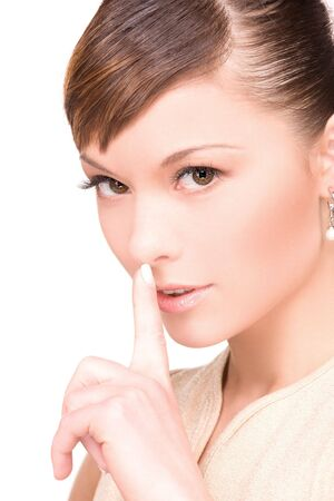 bright picture of young woman with finger on lips Stock Photo - 6376049